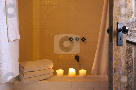 Rustic Bathroom Scene stock photo, Rustic Bathroom Scene with Towels and Candles by Andy Dean