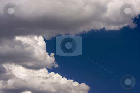 Puffy Clouds on a blue sky. stock photo, Puffy Storm Clouds Forming on a blue sky. by Andy Dean