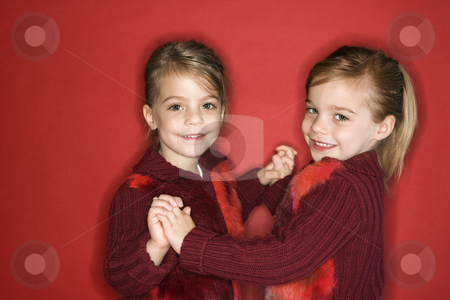 Girl child twin sisters dancing. stock photo, Female children Caucasian twins standing in dance stance. by Iofoto Images