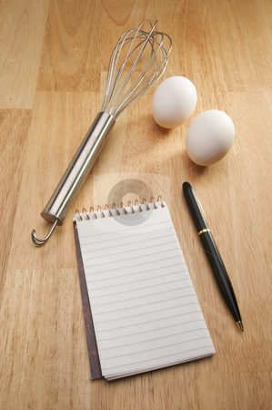 Mixer, Eggs, Pen and Pad of Paper stock photo, Mixer, Eggs, Pen and Pad of Paper on a wood background. by Andy Dean