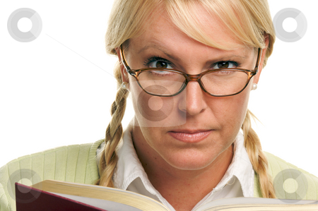 Serious Female with Ponytails and Book stock photo, Serious Female with Ponytails and Book isolated on a White Background. by Andy Dean