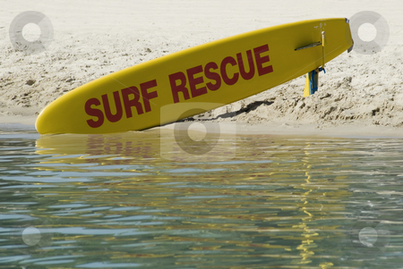 Surf Rescue stock photo, A bright yellow surfboard, standing by for use by surf rescue by Stephen Gibson