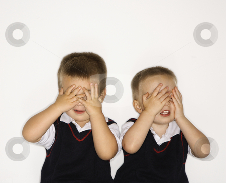 Male twins with hands over eyes. stock photo, Caucasian male children twins with hands over eyes. by Iofoto Images