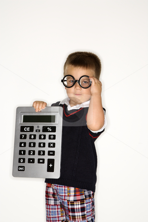 Boy child with calculator. stock photo, Caucasian male child wearing glasses and holding large calculator. by Iofoto Images