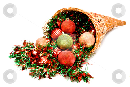 Cornucopia stock photo, A cornucopia filled with holiday Christmas ornaments. by Robert Byron