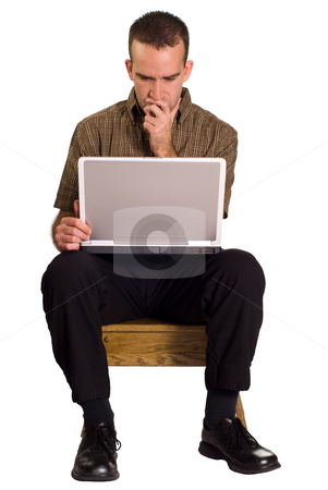 Man Using Computer stock photo, A man sitting on a wooden stool and using a laptop computer, isolated against a white background by Richard Nelson