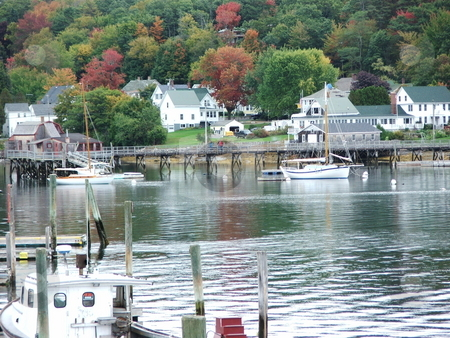 Harbor at  Boothbay stock photo, Early fall colors decorate the hillside surrounding Boothbay Harbor, Maine.  The scenic Boothbay Harbor fishing village is a popular yachting destination in summer months, and a year round travel destination. by Dennis Thomsen