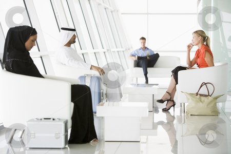 Passengers waiting in airport departure lounge stock photo,  by Monkey Business Images