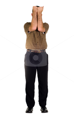 Man Covering His Face stock photo, A full body view of a man covering his face with his arms, isolated against a white background by Richard Nelson