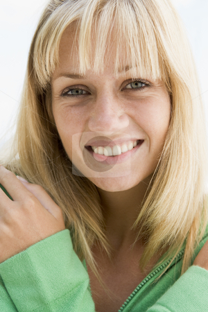 Close-up of young woman stock photo, Close-up of young woman smiling to camera by Monkey Business Images