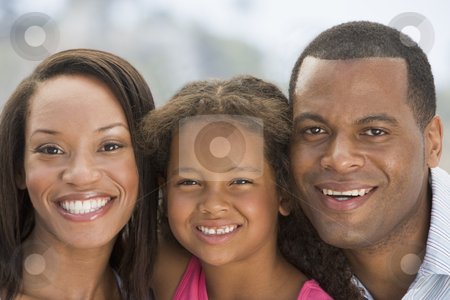 Family outdoors smiling stock photo,  by Monkey Business Images
