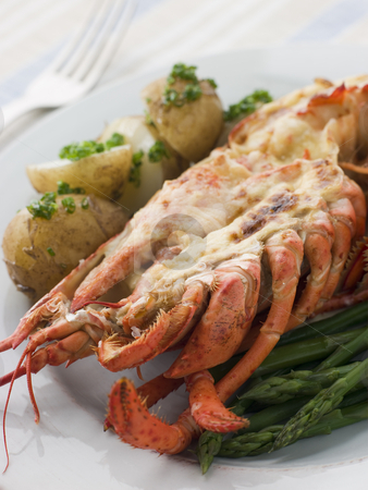 Half a Lobster Thermidor with New Potatoes and Asparagus Spears stock photo,  by Monkey Business Images