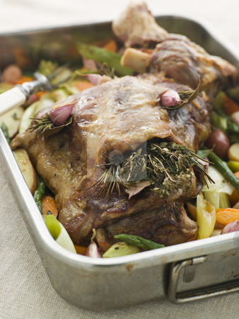 Slow Roasted Shoulder of Lamb Stuffed with Herbs de Provence Roa stock photo,  by Monkey Business Images