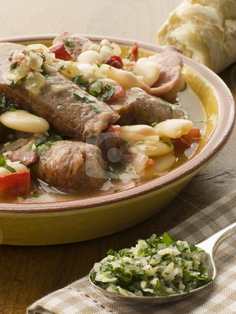 Bowl of Toulouse Sausage and Butter Bean Ragout with Persillade stock photo,  by Monkey Business Images