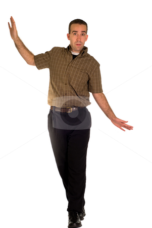 Losing Balance stock photo, Full body view of a young employee losing his balance by Richard Nelson