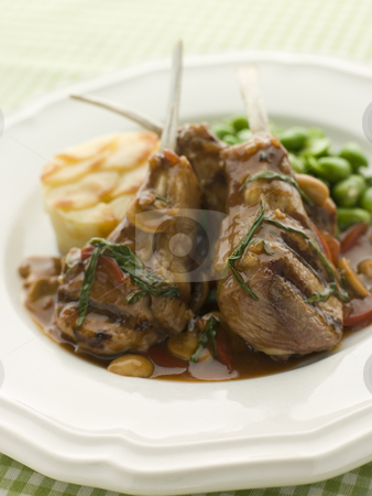 Grilled Lamb Cutlets Chasseur sauce Pomme Anna and Baby Broad be stock photo,  by Monkey Business Images