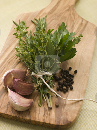 Bouquet Garni Garlic Cloves and Peppercorns stock photo,  by Monkey Business Images