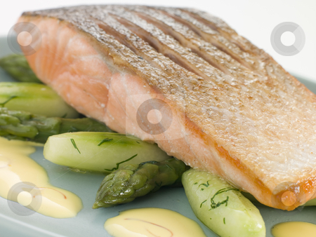Crisp Fried Salmon Supreme with Cucumber Asparagus and Hollandai stock photo,  by Monkey Business Images