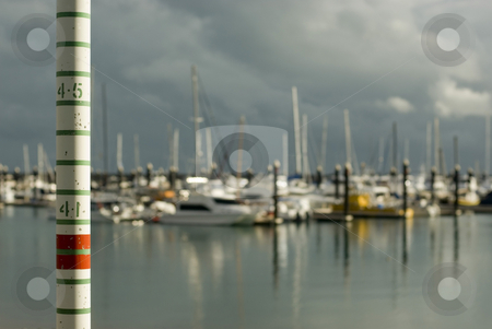 Tide gauge stock photo, A graduated pole for measuring high tides in a marina by Stephen Gibson