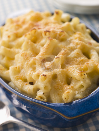 Dish of Macaroni Cheese stock photo,  by Monkey Business Images
