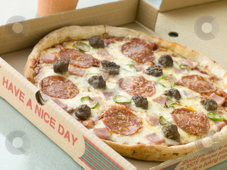 Meat Feast Pizza in a Take Away Box stock photo,  by Monkey Business Images