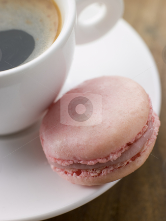 Raspberry Macaroon with a Cup of Espresso stock photo,  by Monkey Business Images