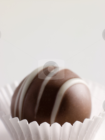 Chocolate Truffle in a Petit four Case stock photo,  by Monkey Business Images