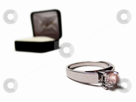 Engagement Ring - Horizontal stock photo, Engagement ring with box. The ring has a square cut diamond and is sitting outside of the box. Horizontally framed shot. by Orange Line Media