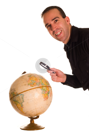 Examining Earth stock photo, Closeup view of a man examining the planet Earth, isolated against a white background by Richard Nelson