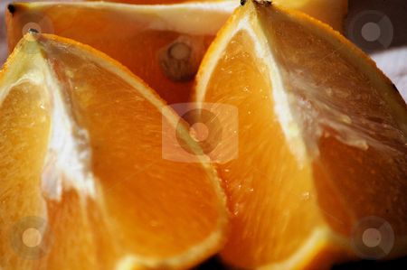 Orange quarters stock photo, Orange quarters ready to eat by Tim Markley