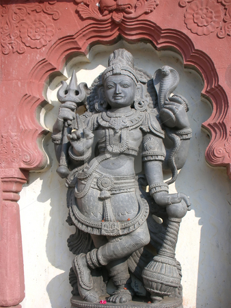 Hindu God Statue stock photo, The statue of hindu god Shiva at Koodala Sangama, near Bijapur City, Karnataka State, India. by S Viswakumar