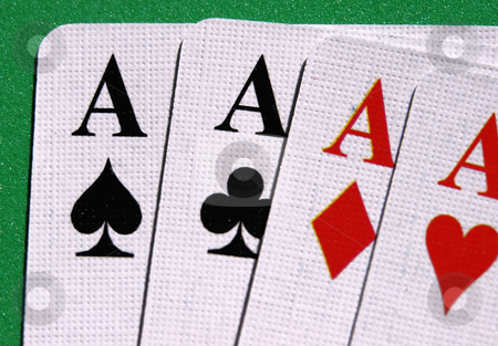 Four aces stock photo, Four aces seen up close in a green table by Tim Markley