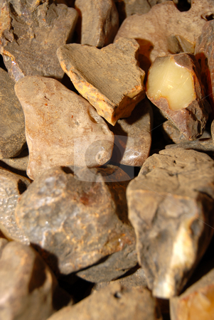 Amber stones stock photo, Natural beauty. Heap of opaque amber, background. by Joanna Szycik