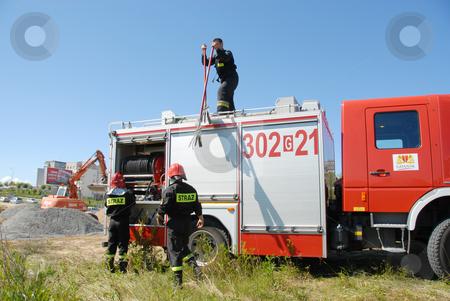 Fireman after work stock photo, A Firemen clean up after a field fire in Gdansk, Poland by Joanna Szycik