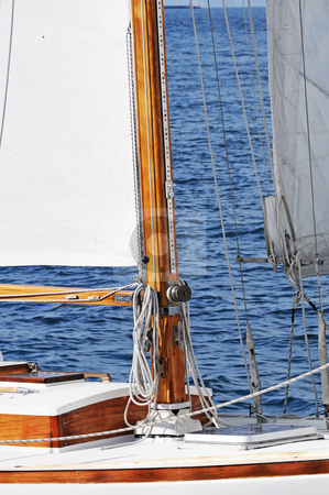 Wooden boat stock photo, Wooden mast on a classic sailboat by Massimiliano Leban