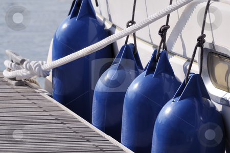 Mooring boat stock photo, Detail of a boat secured to jetty with a rope and bumpers by Massimiliano Leban