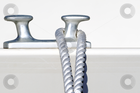Moored boat stock photo, Detail of a rope securing a white boat by Massimiliano Leban