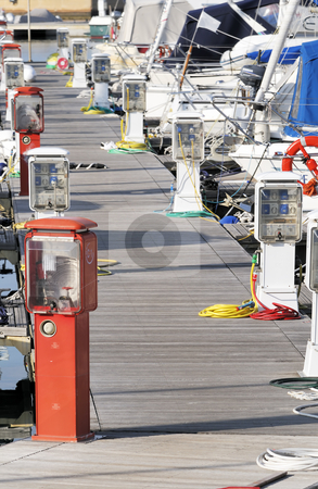 Marina stock photo, Pier with boats in a harbour by Massimiliano Leban
