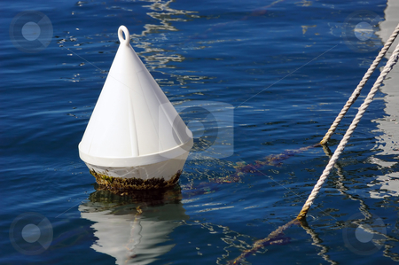 Buoy stock photo, Detail of a white buoy and ropes into the sea by Massimiliano Leban