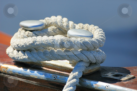 Moored boat stock photo, Close-up of a rope tied-up on a bitt fasten a boat to dock by Massimiliano Leban
