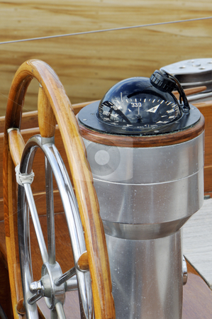 Rudder and compass stock photo, Detail of rudder and compass on a wooden sailboat by Massimiliano Leban