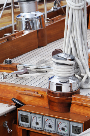 Sailboat detail stock photo, Detail of a wooden boat with tools and navigation instruments by Massimiliano Leban