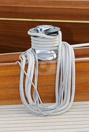 Winch stock photo, Detail of a winch on a wooden sailboat by Massimiliano Leban