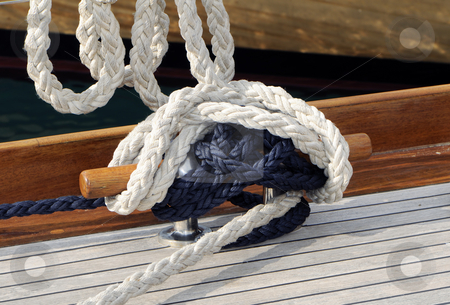 Bitt stock photo, Close-up of a bitt with ropes on a wooden boat by Massimiliano Leban