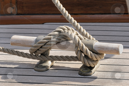 Bitt stock photo, Detail of a rope tied-up on wooden bitt securing boat to dock by Massimiliano Leban