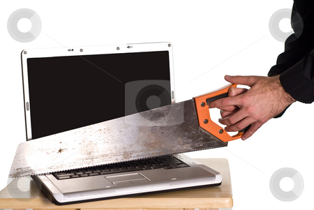 Computer Frustrations stock photo, A man experiencing some computer frustrations and is cutting his laptop in half with a hand saw by Richard Nelson