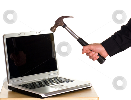 Workplace Frustrations stock photo, A laptop computer about to be smashed with a hammer, isolated against a white background by Richard Nelson