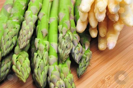 Fresh Asparagus stock photo, Green and white Asparagus on a Bamboo cutting board by Lynn Bendickson
