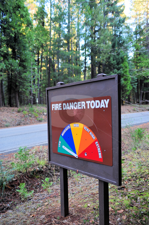 Fire Danger Sign In The Forest stock photo, Sign in the forest that shows the level of fire danger that the forestry department has set by Lynn Bendickson