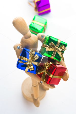 Christmas Mannequin stock photo, Wooden Mannequin holding Christmas ornaments by Jose Wilson Araujo